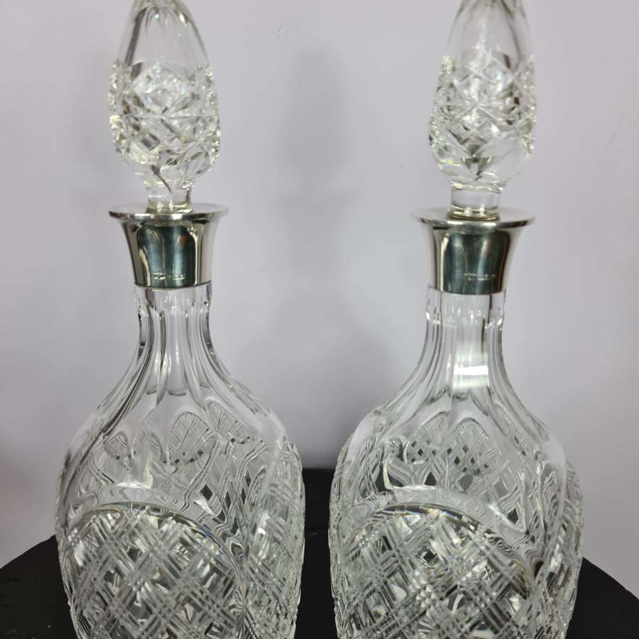 Elegant pair of Silver collared Decanters by Mappin & Webb