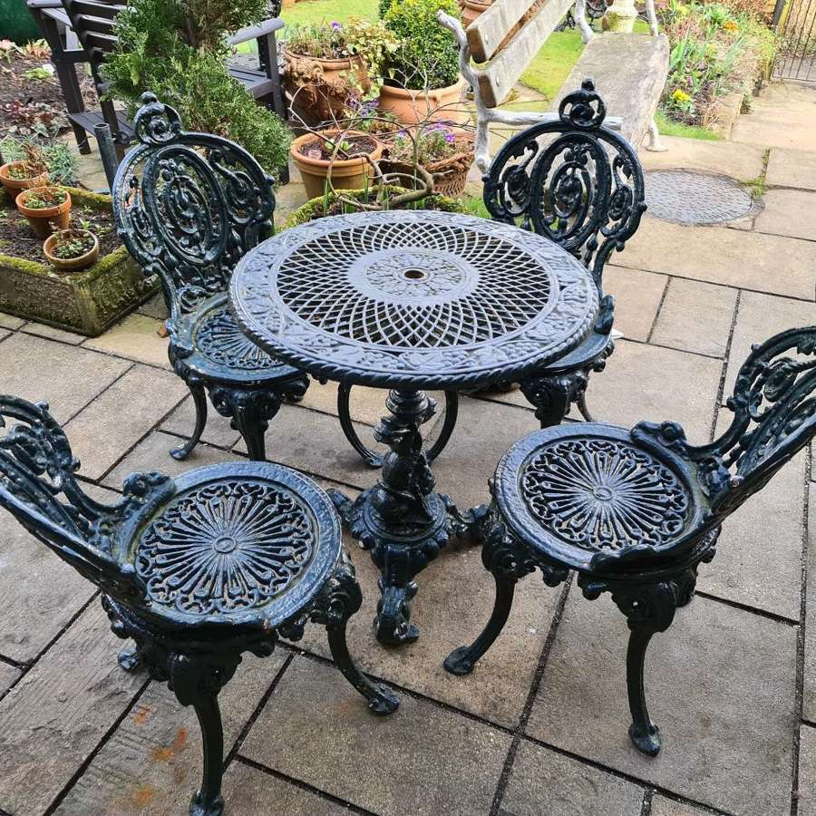 Wonderful set of Cast Iron Garden Table and Four Chairs